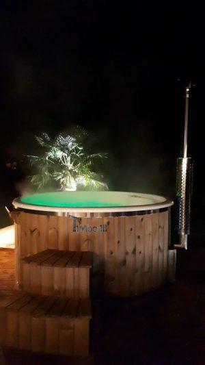 Bain nordique en fibre de verre thermo bois Royal Nathalie Berville la campagne France 1 scaled